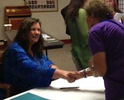 Jean Houston signing books at the Navigating Your Future 2012 Conference